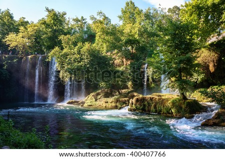 Duden waterfall Antalya, Turkey. Untouched wild nature. Waterfall stream. Panoramic view on Duden Waterfall park. Forest lake. Waterfall surrounded by forest. Vivid summer nature. Travel landmarks.