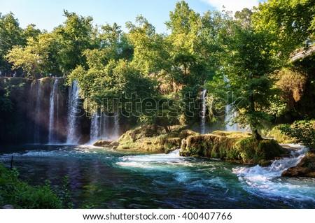 Duden waterfall Antalya, Turkey. Waterfall surrounded by forest. Waterfall stream. Panoramic view on Duden Waterfall. Summer waterfall stream. Waterfall surrounded by forest. Summer waterfall forest