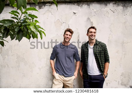Dudes hanging out together, smiling