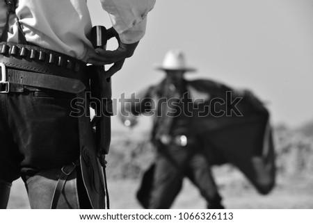 duel between cowboys. affair of honor