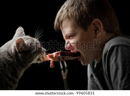 duel of predators - cat and boy on black