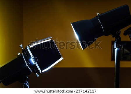 Duel of two professional photo flash lamps in studio