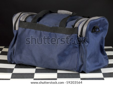 duffel or luggage bag with reflection on black background