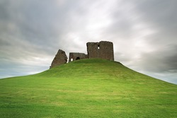 Duffus Castle ruin perched on a grassy mound, moray, Scotland.