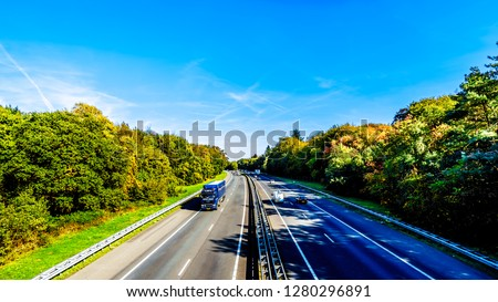 Duinen, Gelderland/the Netherlands - Oct. 5, 2018: View of traffic on the A28 or E232 Freeway between Zwolle and Amesfoort. Viewed from the overpass of the Hierderweg  #1280296891
