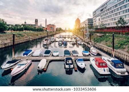 Duisburg Marina with ships and modern buildings