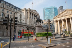 Duke Wellington statue, Royal Exchange and Bank of England in the City of London in England. People on the background