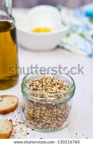 Dukkah in the glass with crusted bread.