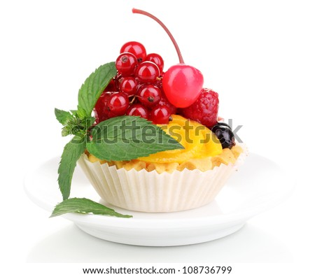 Dulcet cake with fruit and berries isolated on white