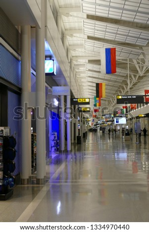 DULLES AIRPORT, WASHINGTON, DC - FEB 10, 2019 - International flags decorate the terminal at Dulles International Airport, Washington, DC #1334970440
