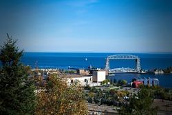 Duluth, Minnesota Skyline Landscape image with Aerial Lift Bridge and Sailboat on Lake Superior