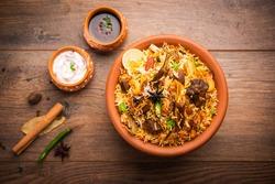 Dum Handi MuttonBiryanior gosht pilaf is prepared in an earthen or clay pot called Haandi or 1 kilo size. Popular Indian non vegetarian food