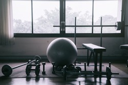 Dumbbell at home fitness to build muscle,Fitness club weight training equipment,heavy weights barbell on the floor in GYM.