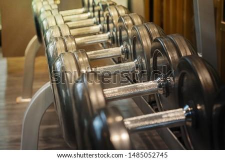 Dumbbell exercises for biceps. soft focus.