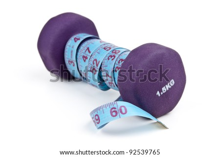 dumbbells and tailoring meter isolated on white background