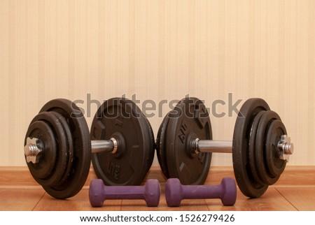 dumbbells for fitness and dumbbells for men lie on the floor