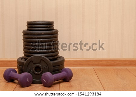 dumbbells for fitness and metal dumbbells lie on the floor