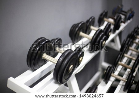 Dumbbells for sports. Dumbbells are in a row. Sport equipment. Occupation for men. Metal products.
