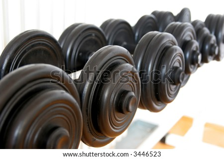 Dumbbells in gym stadium