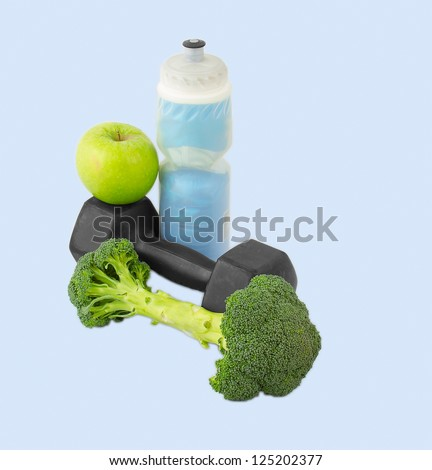 Dumbbells made of broccoli with water bottle and green apple
