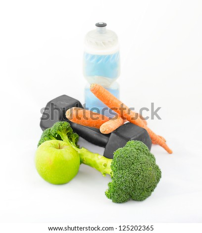 Dumbbells made of broccoli with water bottle, carrots and green apple