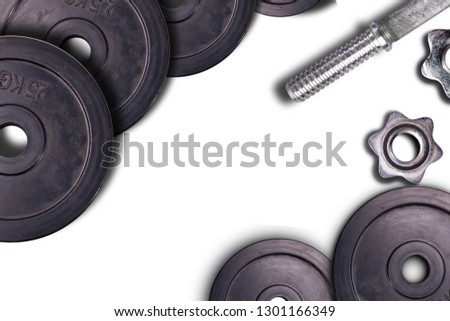 Dumbbells on carbon background. Dumbbells and weights are lying on the floor in the gym. Barbell set and gym equipment. Metal loads in the fitness club.