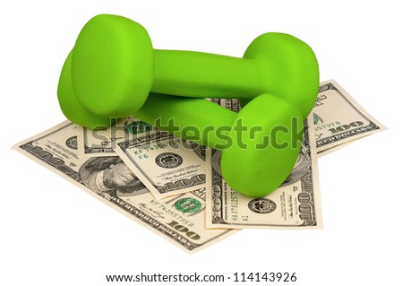 Dumbbells on heap of dollars isolated on a white background