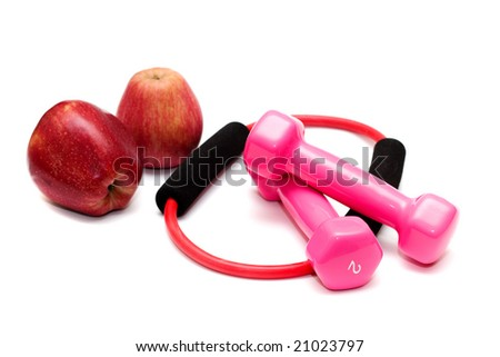 Dumbbells with rubber and apples on the white,fitness