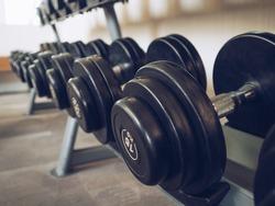 Dumbells set left on the racks in the gym.