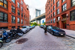 DUMBO district in Brooklyn. NEW YORK, USA. Dumbo is a neighborhood in the New York City borough of Brooklyn. Red buildings and Manhattan Bridge.