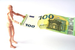 Dummy holding 100 euro banknote. Money or business concept. Abstract conceptual image