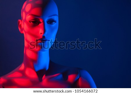 Dummy in red. Female mannequin. Silhouette of a female mannequin.
