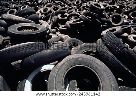 Dump of discarded automobile tires that are to be burned creating a pollution smoke hazard. Ca. 1973-75.