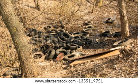 Dump rubber tires in the park, Tires, wheels, recycling, pollution, landfill, garbage, Europe, Asia, Africa, nature, spring, tourism, green area, land pollution, wheel dump, tire dump #1355119751