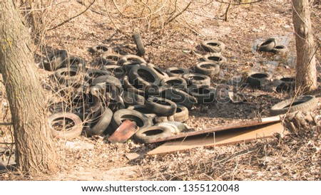 Dump rubber tires in the park, Tires, wheels, recycling, pollution, landfill, garbage, Europe, Asia, Africa, nature, spring, tourism, green area, land pollution, wheel dump, tire dump #1355120048