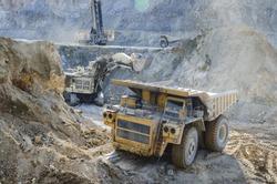 Dump truck in the open pit mine