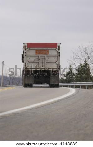 Dump Truck on the Highway - stock photo