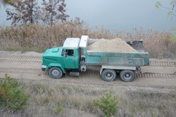 Dump truck transports sand and other minerals in the mining quarry. Heavy industry