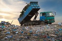 Dump truck unloading waste on a landfill