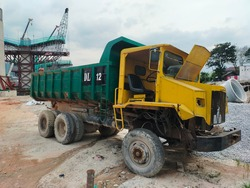 Dump trucks are used to transport  loose materials such as dirt, sand, ores, gravel, and demolition waste across mining, civil or major construction sites. DT 12 on a lorry means Dumper Lorry No. 12.