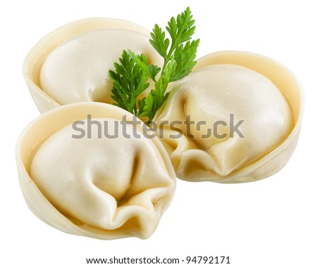 Dumplings and parsley - russian pelmeni - italian ravioli - isolated on white with clipping path