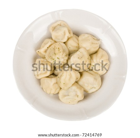 dumplings in a plate isolated on white background