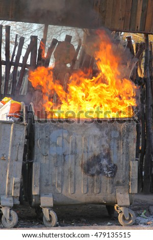 Dumpster Fire With Heavy Smoke Pollution From Garbage #479135515