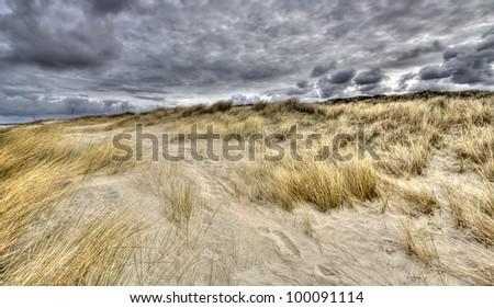 Dune and rainclouds on the Dutch coast