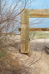 Dune protection wood fencing in a natural park.