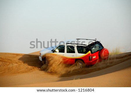 Dune riding in desert outside of Dubai