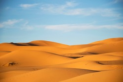Dunes in the sahara, merzouga morocco. Golden desert dunes. Hills of the sahara. Evening in the desert. Lanscape morocco. Scenic view.