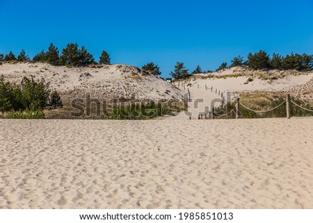 Dunes in the Slowinski National Park. Landscape with beautiful sky, clouds and dunes in the sun in Leba. Zdjęcia stock ©
