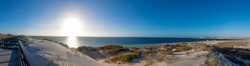 Dunes of Coral Bay Australia panorama during early evening close to the sunset