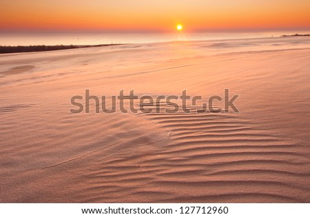dunes of sand at sunset